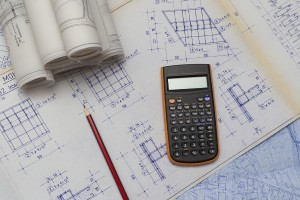 Calculator and Pen on Structural Drawings for Site Design