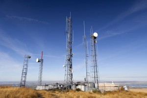 Multiple Towers Telecom Compound with blue sky background